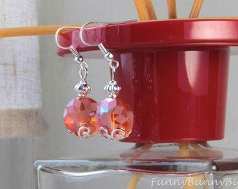 Drop earrings with orange Crystal beads