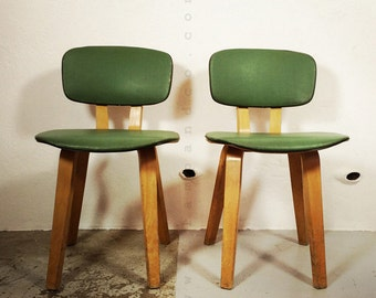 Pair of chairs in moulded wood from the fifties.