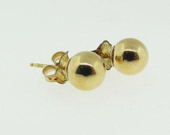 14 K gold 6 mm ball earrings.