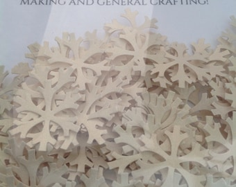 Snowflakes made from cream cardstock, 2cm wide. Ideal for table confetti, cardmaking and general crafting.