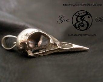 Silver bird skull pendant