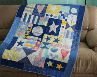 Stars, hearts and circles appliqued quilt