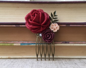 Hair comb with burgundy and light pink flowers, faux pearl and brass leaf accents.