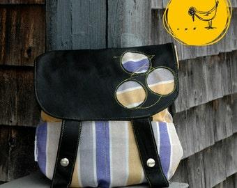 Purple and yellow striped handbag