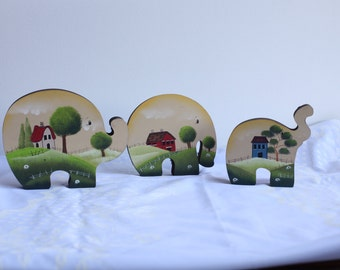 Set of three decorative elephants for home .