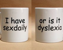 I have sex daily, or is it dyslexia - printed mug. Novelty, fun, joke student humour or office type humorous slogan printed on a gift mugs.