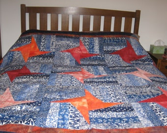 Blue and White  Strips and Orange Stars Quilt