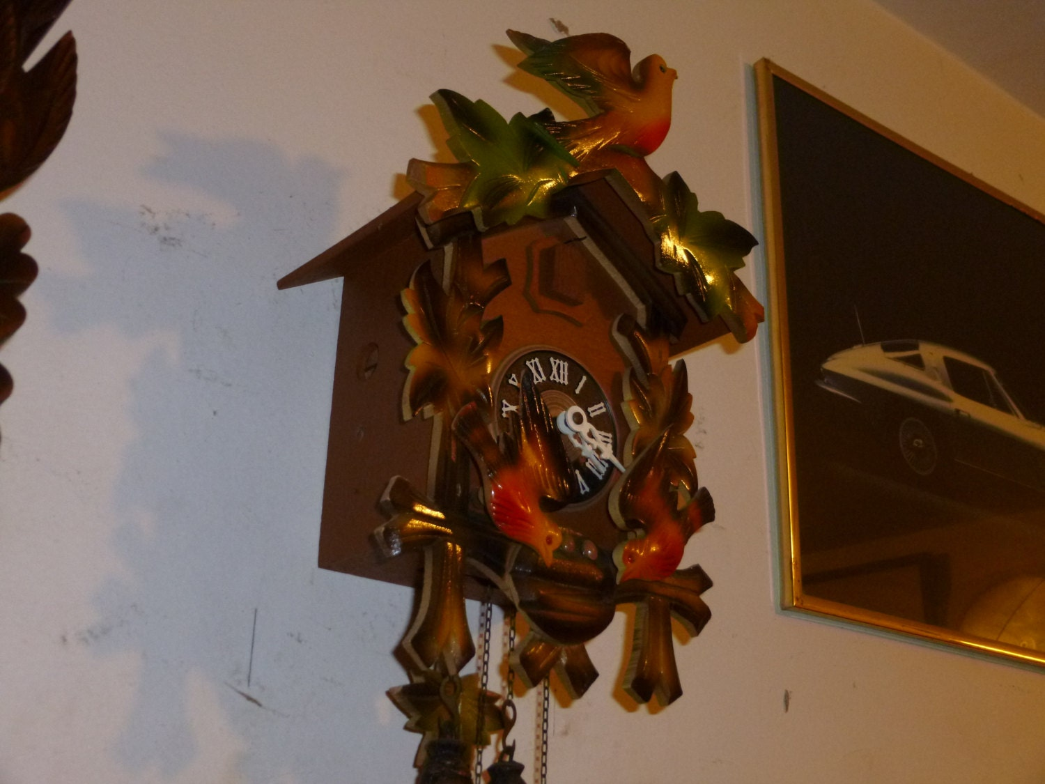 Colorful rocking bird cuckoo clock - Colorful cuckoo clock ...