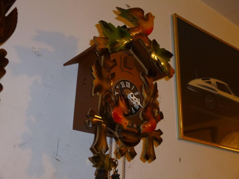 colorful rocking bird cuckoo clock