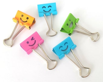 Set of 5 smiling faces metal binder clips