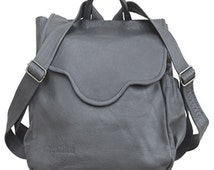 "A ""GABI"" grey. Leather backpack purse with adjustable straps that is both comfortable and fashionable. Can hold many useful items."
