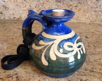 Blue and green whiskey jug