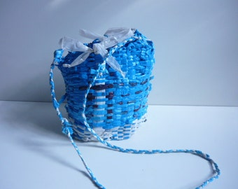 Handwoven Recycled Plastic Bag: mostly blue with white stripes, flecks of black and maroon