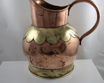 Antique copper brewery jug