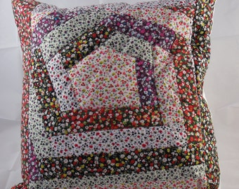 Red, black and white floral patchwork cushion