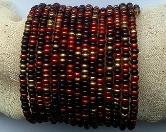 Bead bracelet. Dark brown, red brown and golden beads. Multi-row.