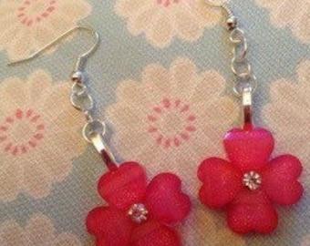 Pink flower earrings.