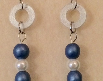 Blue and white pearl earrings .