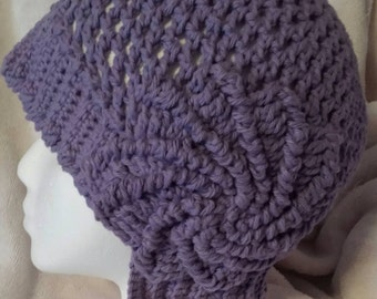 Crocheted, asymmetrical, cloche hat for spring. Designed and handcrafted in 100% cotton.