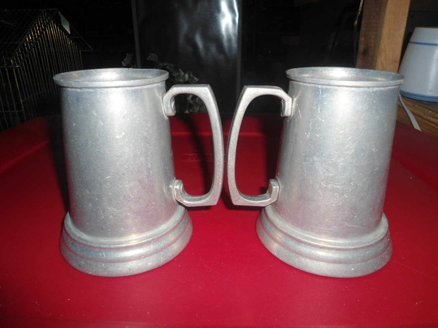 A Pair Of Vintage Pewter Glass Bottom Tankards Steins Beer