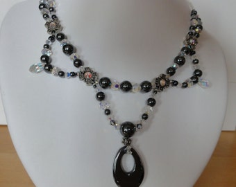 Necklace of hematite and white beads