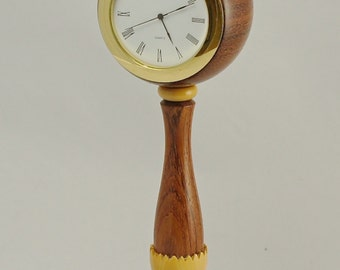 This clock is for a desk or mantle shelf and stands just over 9 inches tall. Very elegant with very good proportions.