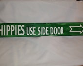 Hippies use side door!  Silly Bright Green sign for Fun, great for the Cabin, the garage, at the lake, just for fun!