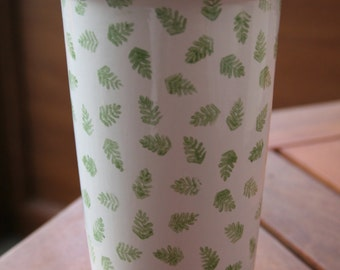Ceramic travel mug hand decorated with green fern leaves