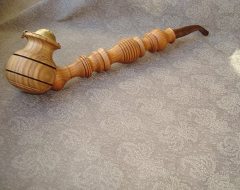 Wooden pipe. Smoking pipe. Tobacco smoking pipe