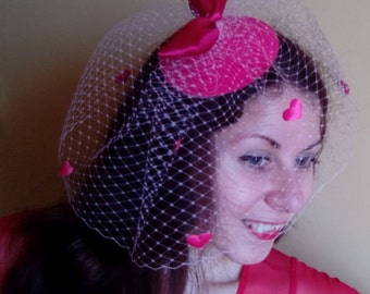 Pink hat with a veil and hearts