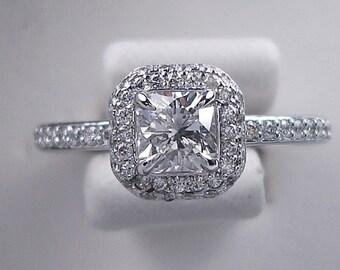 Stunning 1.00 ctw Radiant cut diamond ring with a gorgeous 0.55 ct G/SI1 Clarity Enhanced Radiant cut diamond