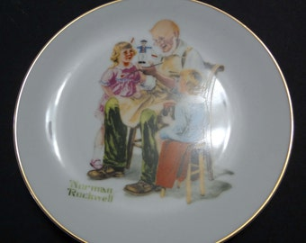 Set of 4 Norman Rockwell Plates