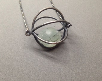 cage pod necklace oxidized sterling silver modern art jewelry kinetic jewelry prehinite crystal ball rutile