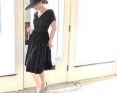 1950s Black Rayon Surplice Front Dress