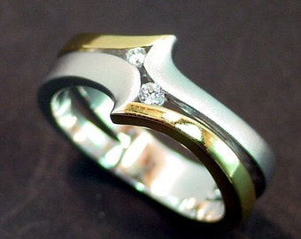 14K two tone gold ring set with .10 carats of diamonds