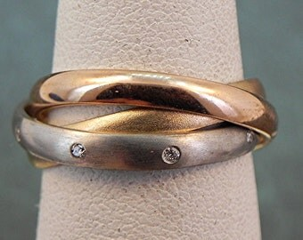 14K gold Russian Three rolling wedding rings with .08 carats of diamonds.