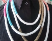 Long knitted statement necklace.