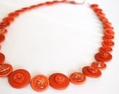 Orange button necklace handmade with upcycled buttons.