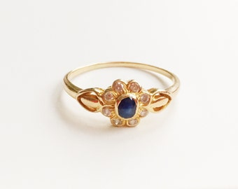 V I N T A G E / 18k flower / yellow gold with diamonds and a blue sapphire / a flower cluster ring / just over size 7.25