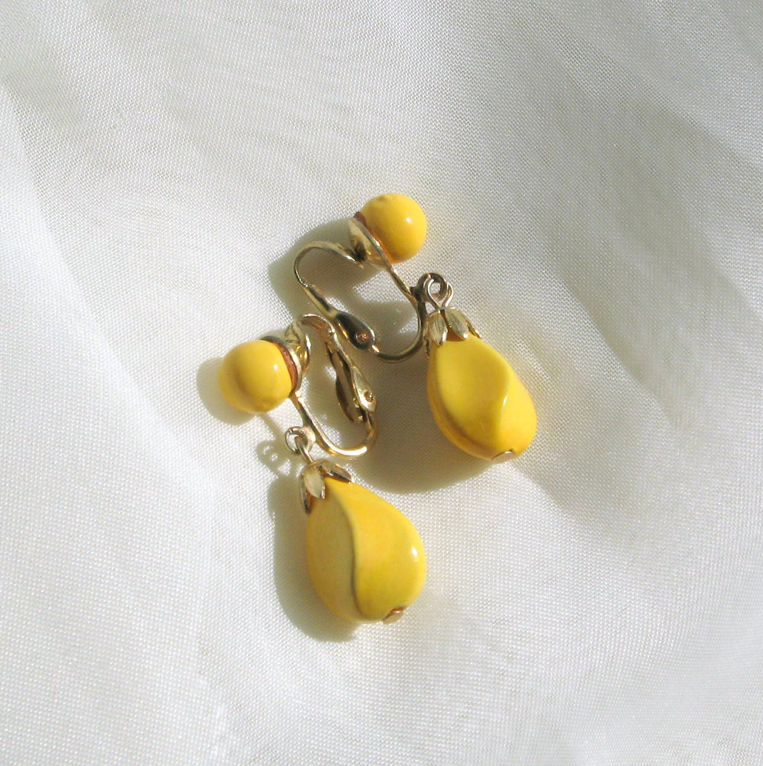 hong kong clip earrings yellow cabochons dangle by