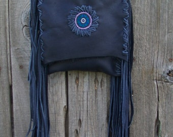 Navy blue leather handbag with a beaded mandala
