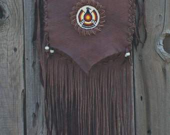Brown leather handbag with thunderbird totem , Fringed crossbody handbag