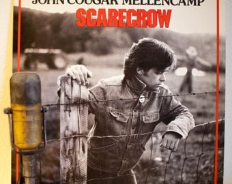 """ON SALE John Cougar Mellencamp Vinyl Record LP 1980s Classic Rock and Roll """"Scarecrow""""(1985 Riva w/""""R.O.C.K. In The U.S.A."""" & """"Lonely Ol' Ni"""