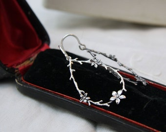 Silver twig earrings. Twig and flower sterling earrings. Twig jewelry. Leaf branch earrings.  Woodland earrings. Woodland jewelry
