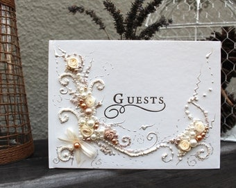 """Beautiful Wedding guest book in gold, champagne and ivory, 10""""x11"""" with a pen attached or 6""""x8.5"""", hand decorated with roses and pearls"""