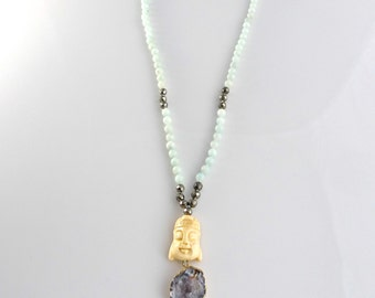 handknotted brazilian amazonite and faceted pyrite with carved bone buddha head focal and agate druzy pendant; hand knotted necklace