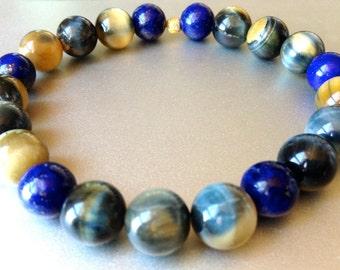 transition to forgiveness. lapis lazuli blue gold tiger eye gemstone mala bracelet gold vermeil