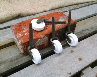 Set of 4 Ceramic and Iron Casters