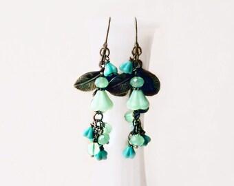 Mint Flower Earrings. Long Chandelier Earrings Wire Wrapped with Czech Glass + Antique Bronze Leaf Charms. Seafoam + Teal Cascading Earrings
