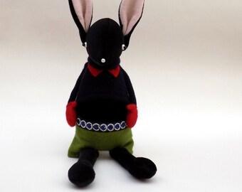 Black Velour Rabbit  -  Handmade plush sculpture wearing navy woollen pullover and red felt mittens.